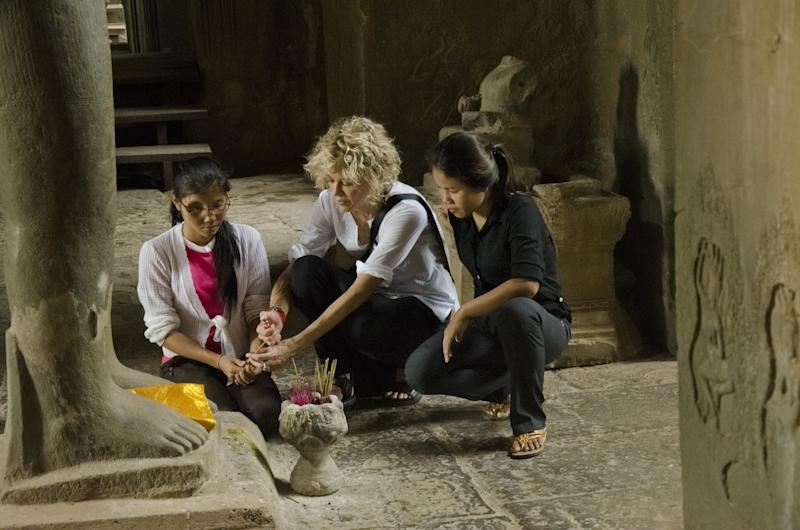 """This undated image provided by PBS shows actress Meg Ryan in Cambodia. Ryan, America Ferrara and Olivia Wilde are among the actresses who brought their star power to the PBS documentary """"Half the Sky,"""" which details efforts to help exploited women worldwide. It airs Monday and Tuesday, Oct. 1-2. (AP Photo/PBS, David Smoler)"""