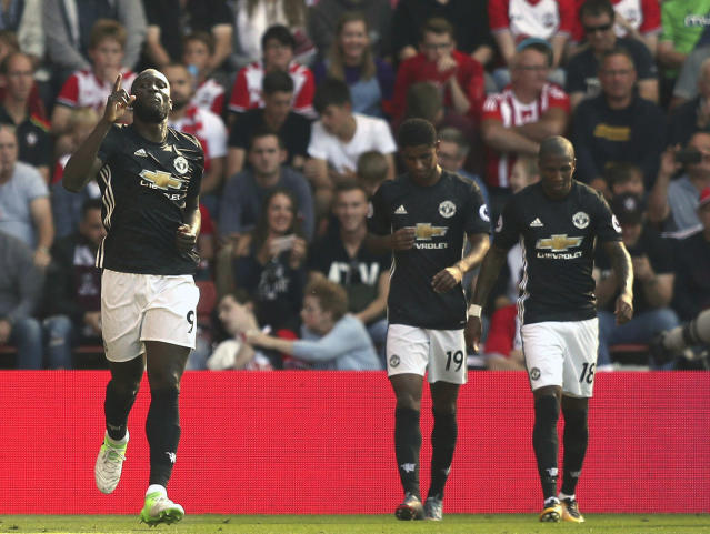 "<a class=""link rapid-noclick-resp"" href=""/soccer/teams/manchester-united/"" data-ylk=""slk:Manchester United"">Manchester United</a>'s <a class=""link rapid-noclick-resp"" href=""/soccer/players/romelu-lukaku/"" data-ylk=""slk:Romelu Lukaku"">Romelu Lukaku</a>, left, celebrates scoring his side's only goal at <a class=""link rapid-noclick-resp"" href=""/soccer/teams/southampton/"" data-ylk=""slk:Southampton"">Southampton</a>. (PA via AP)"