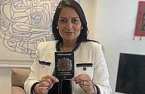 Priti Patel, the Home Secretary, holds the new passport, which is currently being issued. (Home Office)
