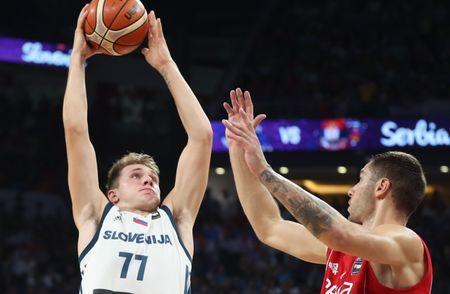 FILE PHOTO: Basketball - Slovenia v Serbia - European Championships EuroBasket 2017 Final - Istanbul, Turkey - September 17, 2017 - Luka Doncic of Slovenia and Stefan Jovic of Serbia in action. REUTERS/Osman Orsal