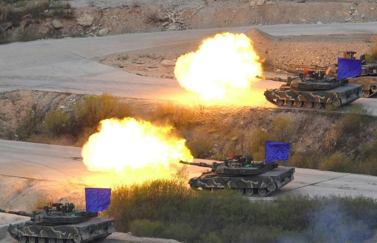 South Korean K1A2 tanks fire live rounds during a joint live firing drill between South Korea and the US at the Seungjin Fire Training Field in Pocheon on April 26, 2017