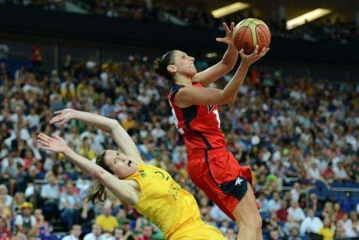 US guard Diana Taurasi jumps over Australian guard Belinda Snell