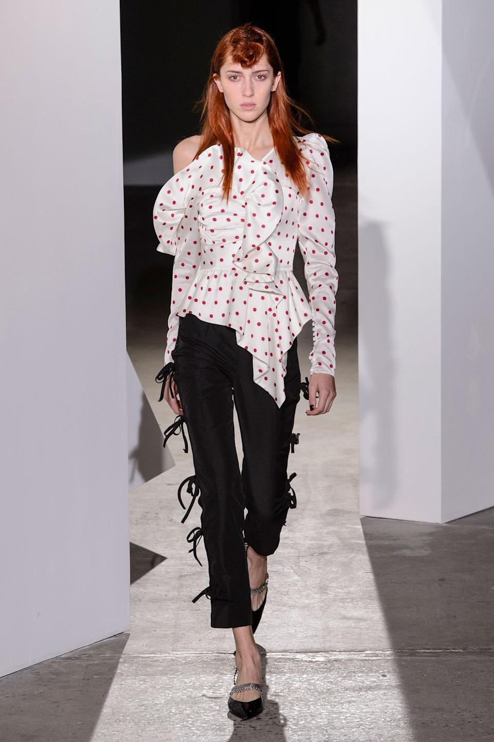 <p>Red and white polka dot statement blouse and black trousers from the SS18 Self Portrait collection. (Photo: ImaxTree) </p>