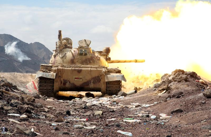 Armed Yemeni tribesmen from the Popular Resistance Committees fire from a tank in the area of Sirwah, west of Marib city, on November 3, 2015