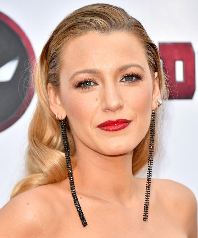<p>From Dolce and Gabbana to Brandon Maxwell, red lipstick was a constant during the fall 2018 shows. What finish you choose — satin, glossy, matte, metallic — is up to you, and it's your chance to personalize the timeless beauty staple. Blake Lively paired her satin lippy with bronze shadow for a gorgeous look in the same color family. </p>
