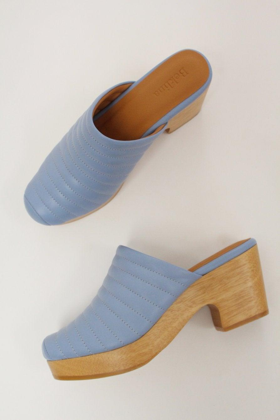 "<h3><h2>Beklina Ribbed Clog</h2></h3><br>Newcomer Beklina offers a ribbed leather style — a new take on a tried-and-true silhouette.<br><br><strong>Beklina</strong> Ribbed Clog, $, available at <a href=""https://go.skimresources.com/?id=30283X879131&url=https%3A%2F%2Fwww.beklina.com%2Fcollections%2Fshoes%2Fproducts%2Fbeklina-ribbed-lego-clog-matisse-blue"" rel=""nofollow noopener"" target=""_blank"" data-ylk=""slk:Beklina"" class=""link rapid-noclick-resp"">Beklina</a>"