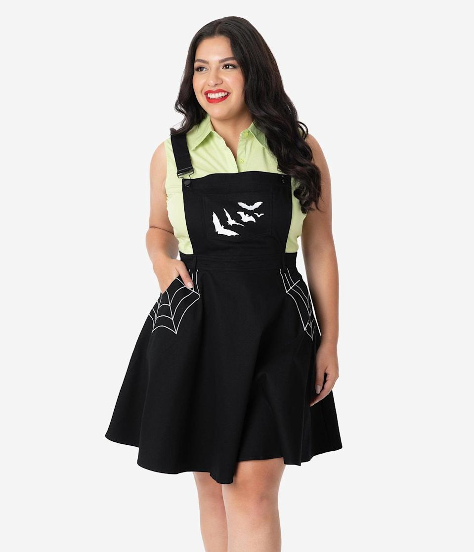 <p>Celebrate the haunted holiday with the <span>Hell Bunny Plus Size Black Spiderweb and Bats Miss Muffet Pinafore Dress</span> ($78).</p>