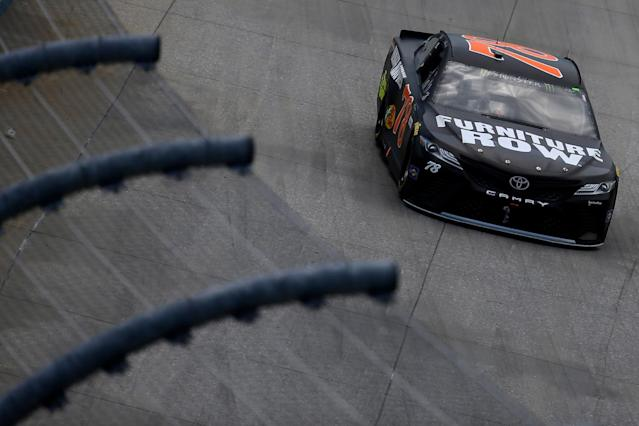 "DOVER, DE – JUNE 04: <a class=""link rapid-noclick-resp"" href=""/nascar/sprint/drivers/380/"" data-ylk=""slk:Martin Truex Jr."">Martin Truex Jr.</a>, driver of the #78 Furniture Row/Denver Mattress Toyota, races during the Monster Energy NASCAR Cup Series AAA 400 Drive for Autism at Dover International Speedway on June 4, 2017 in Dover, Delaware. (Photo by Chris Trotman/Getty Images)"