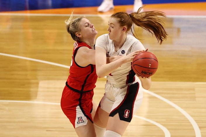Stanford forward Ashten Prechtel (11) attempts to control the ball as Arizona forward Cate Reese (25) defends during the national championship game.