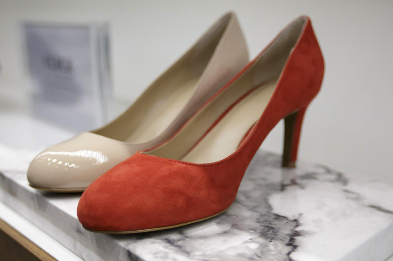 """<p> High heels are on display in a store in London, Monday March 6, 2017. British lawmakers are due to debate banning mandatory high heels in the workplace on Monday, in response to a petition started by a receptionist who was sent home for wearing flat shoes. The debate is non-binding, but a committee of lawmakers has found that """"discriminatory dress codes"""" are commonplace and called for urgent action. (AP Photo/Tim Ireland) </p>"""