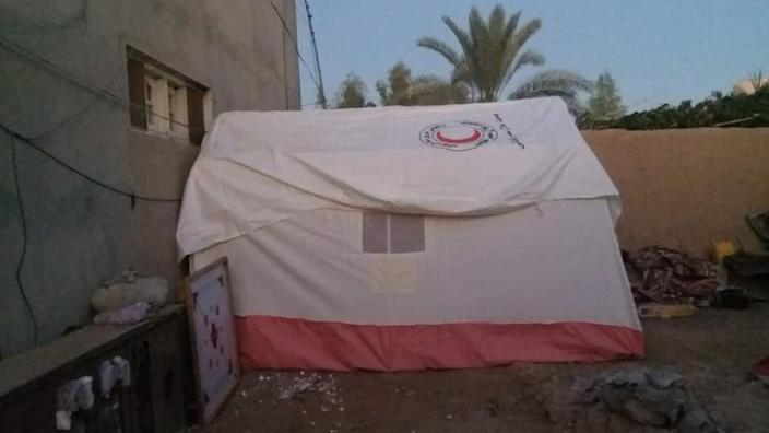 A tent in a courtyard