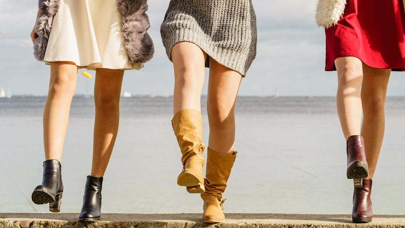 Three women walking in boots