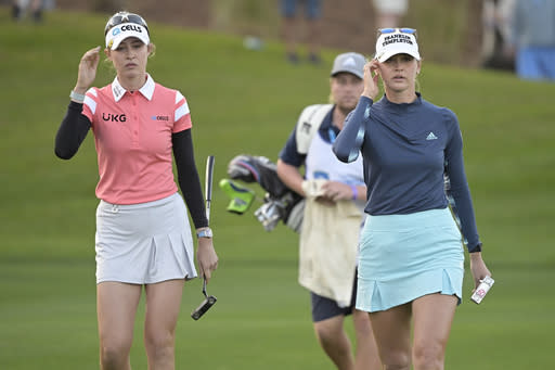 Jessica Korda, right, and her sister Nelly Korda walk to the 18th green during the final round of the Tournament of Champions LPGA golf tournament, Sunday, Jan. 24, 2021, in Lake Buena Vista, Fla. (AP Photo/Phelan M. Ebenhack)