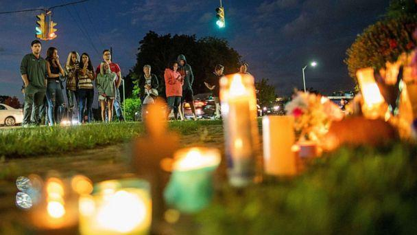 PHOTO: People pay respect in a makeshift memorial during a candlelight vigil for travel blogger Gabby Petito in Blue Point, New York, Sept. 24, 2021. (Eduardo Munoz/Reuters)