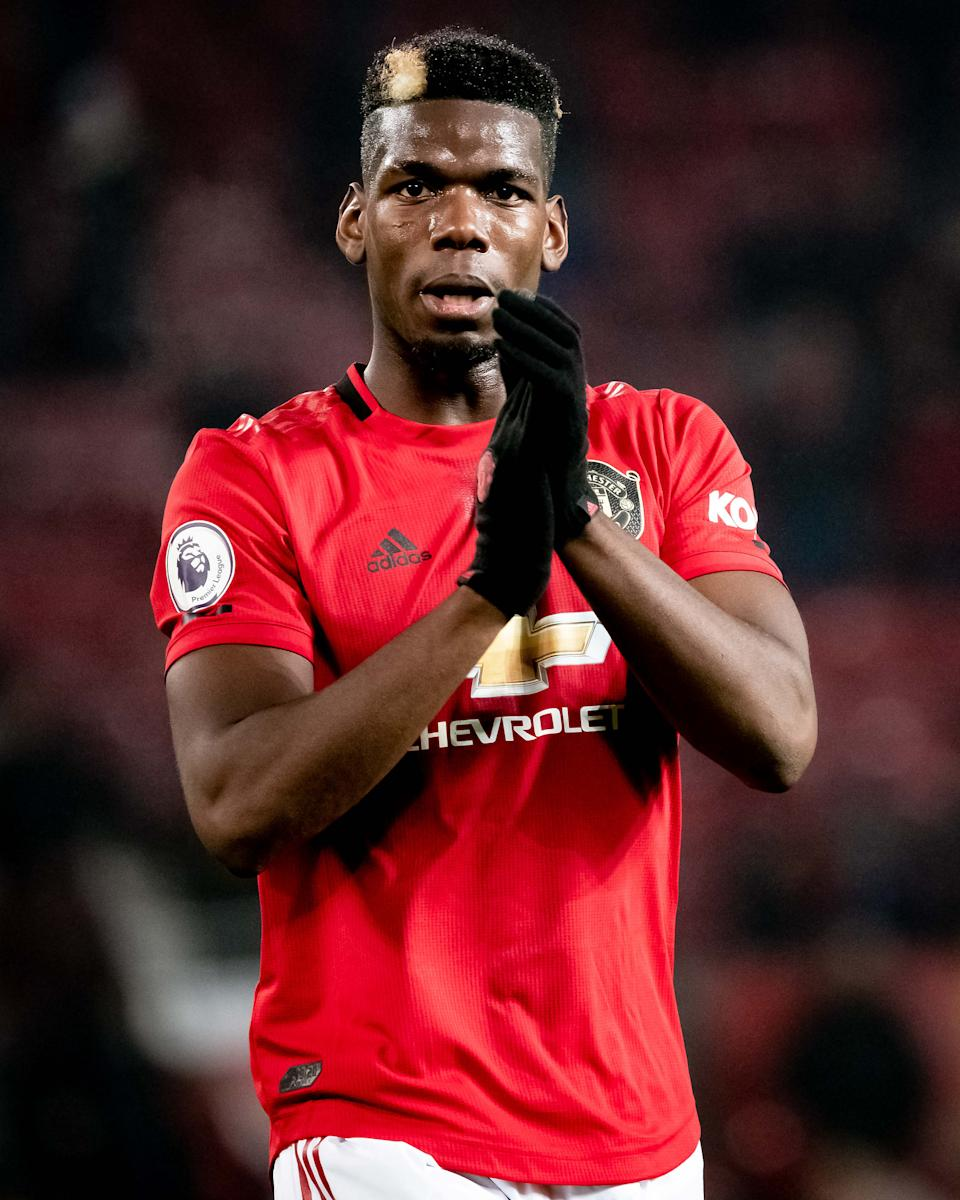 MANCHESTER, ENGLAND - DECEMBER 26: Paul Pogba of Manchester United in action during the Premier League match between Manchester United and Newcastle United at Old Trafford on December 26, 2019 in Manchester, United Kingdom. (Photo by Ash Donelon/Manchester United via Getty Images)