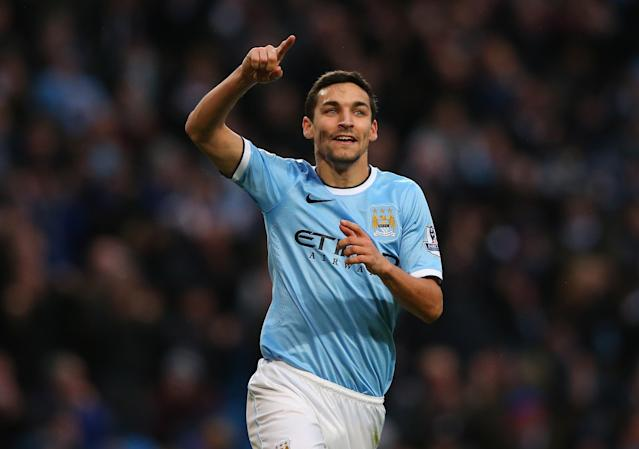 MANCHESTER, ENGLAND - NOVEMBER 24: Jesus Navas of Manchester City celebrates after scoring the sixth goal during the Barclays Premier League match between Manchester City and Tottenham Hotspur at Etihad Stadium on November 24, 2013 in Manchester, England. (Photo by Alex Livesey/Getty Images)