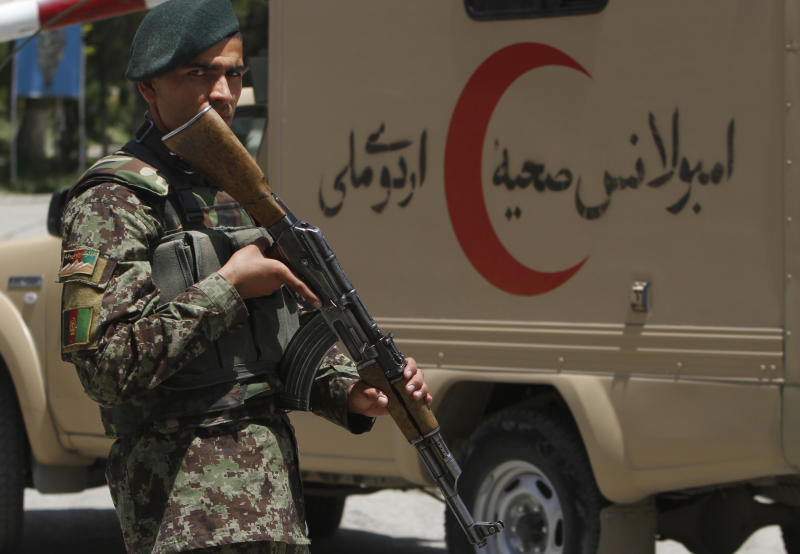 An Afghan National Army soldier patrols the gate of the military hospital next to an ambulance in Kabul, Afghanistan, Sunday, May 13, 2012. 2012. (AP Photo/Rahmat Gul)