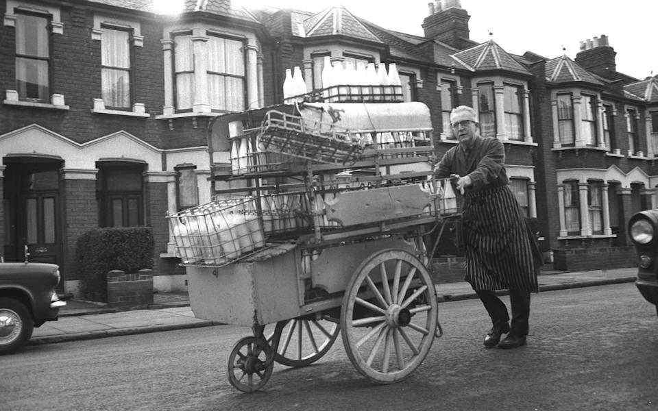 A milkman does his rounds in London's East End during the 1960s. (Photo by Steve Lewis/Getty Images)  - Getty