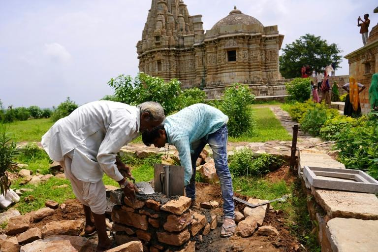 In Chittorgarh, a lightning bolt struck a tower and sent a huge chunk of stone plummeting to the ground (AFP/Himanshu SHARMA)