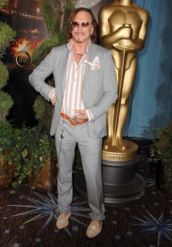 """In addition to learning a new red carpet pose (the hand in the pants -- not cute), Mickey Rourke should also learn that a dingy 'do, a wallet chain, and """"Miami Vice""""-inspired loafers don't go with anything. Steve Granitz/<a href=""""http://www.wireimage.com"""" target=""""new"""">WireImage.com</a> - February 2, 2009"""