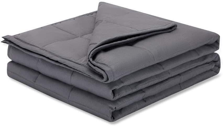 """This weighted blanket is made from natural cotton. With almost 10,000 reviews, it's """"I<a href=""""https://www.huffpost.com/topic/in-its-prime"""" target=""""_blank"""" rel=""""noopener noreferrer"""">n Its Prime</a>"""" as we like to say.<a href=""""https://amzn.to/3k0s3Nx"""" target=""""_blank"""" rel=""""noopener noreferrer"""">Originally $120, get it now for $80 at Amazon</a>."""