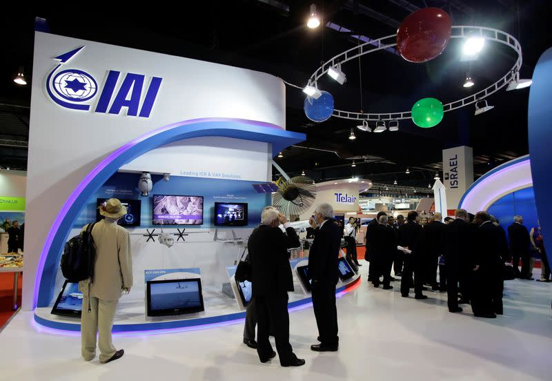 FILE PHOTO: Trade visitors gather at the IAI exhibition booth at the Singapore Airshow