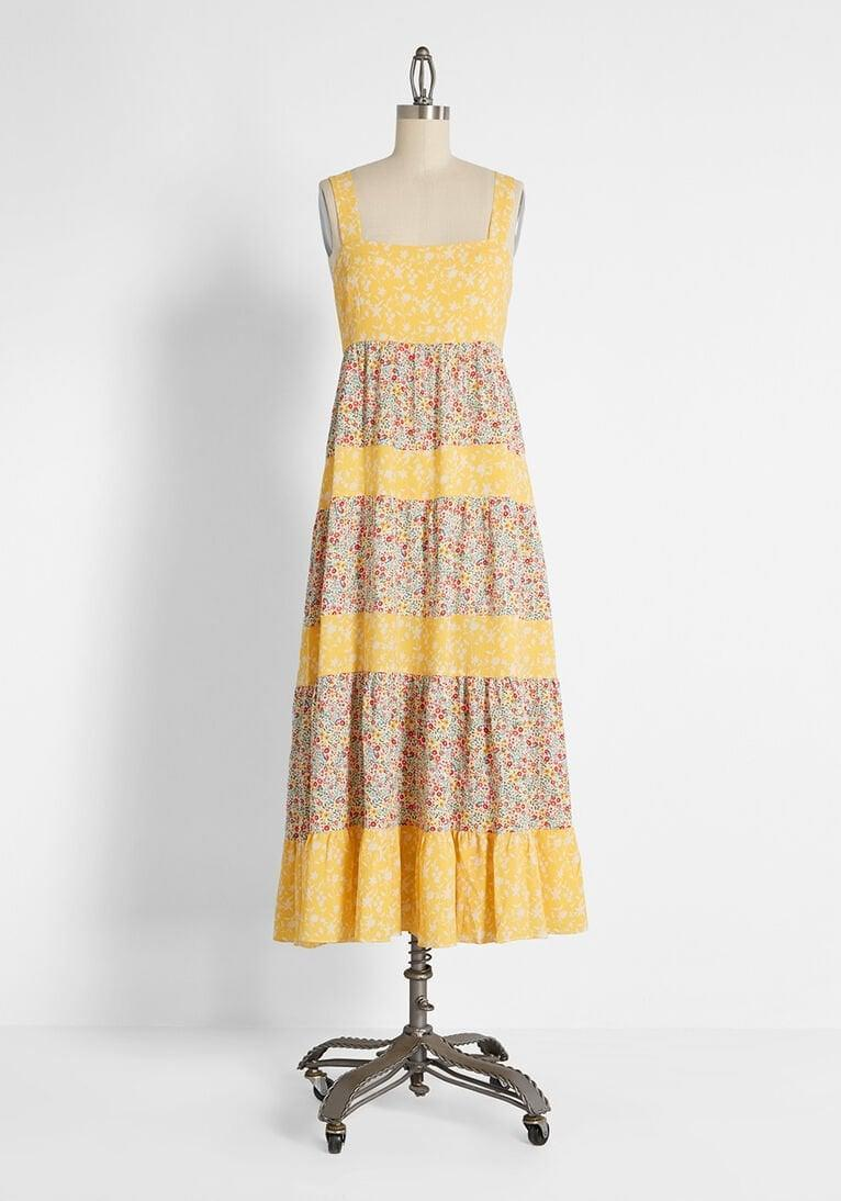 <p>Channel literal sunshine in this <span>Art of the Mixed Print Midi Dress</span> ($119).</p>