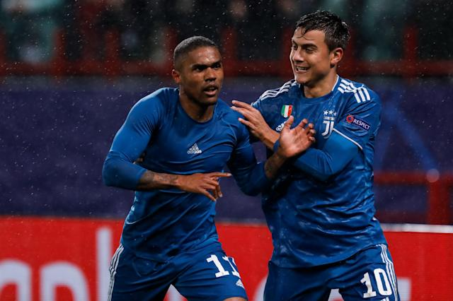 Douglas Costa (L) of Juventus celebrates his goal with Paulo Dybala during the UEFA Champions League Group D match between Lokomotiv Moskva and Juventus FC on November 6, 2019 at RZD Arena in Moscow, Russia. (Photo by Mike Kireev/NurPhoto via Getty Images)
