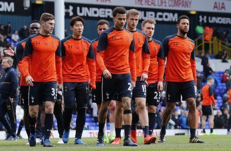Tottenham's Dele Alli warms up with teammates before the game