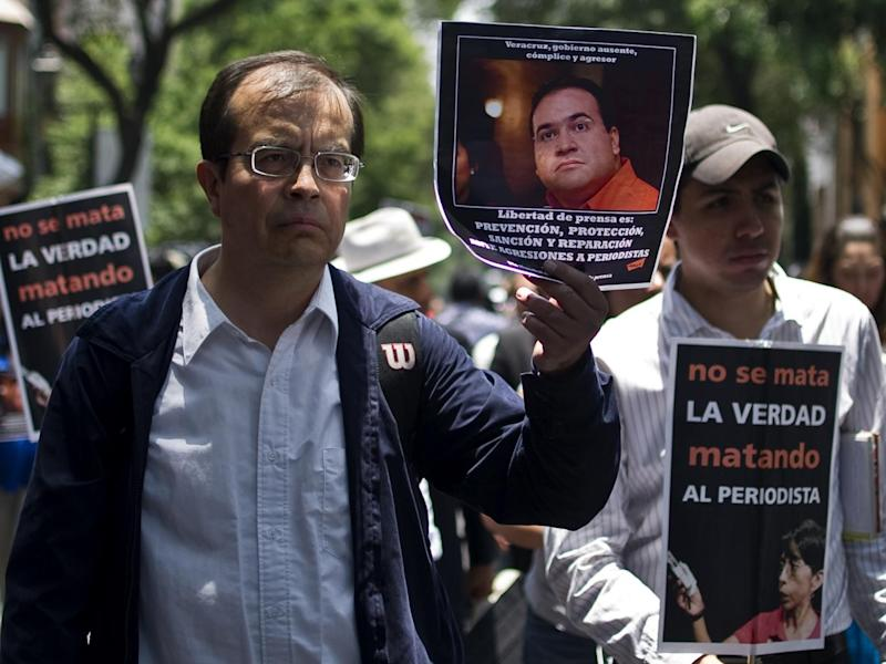 Mexican journalists protesting in Veracruz at the killing of their colleagues in 2012. At least 17 have died since Duarte came to power in 2010 (AFP/Getty Images)