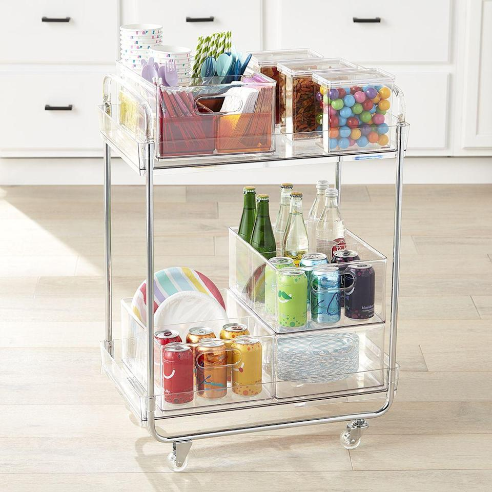 "<p><strong>Container Store</strong></p><p>containerstore.com</p><p><strong>$99.99</strong></p><p><a href=""https://go.redirectingat.com?id=74968X1596630&url=https%3A%2F%2Fwww.containerstore.com%2Fs%2Fstorage%2Fstorage-the-home-edit-collection%2Fthe-home-edit-kitchen-pantry-collection%2Fthe-home-edit-clear-rolling-cart%2F123d%3FproductId%3D11013221&sref=https%3A%2F%2Fwww.townandcountrymag.com%2Fstyle%2Fhome-decor%2Fg34074224%2Fthe-home-edit-where-to-buy%2F"" rel=""nofollow noopener"" target=""_blank"" data-ylk=""slk:Shop Now"" class=""link rapid-noclick-resp"">Shop Now</a></p>"