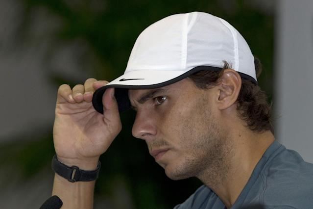 Spain's Rafael Nadal attends a press conference for the Shanghai Masters tennis tournament at the Qizhong Forest Sports City Tennis Center, in Shanghai, China, Tuesday, Oct. 8, 2013. (AP Photo/Ng Han Guan)