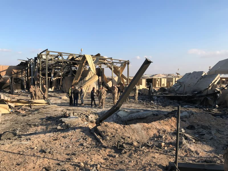 U.S. soldiers inspect the site where an Iranian missile hit at Ain al-Asad air base in Anbar province