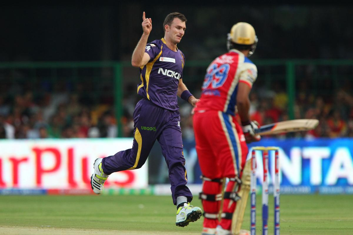Ryan McLaren celebrates the wicket of Mayank Agarwal during match 12 of the Pepsi Indian Premier League between The Royal Challengers Bangalore and The Kolkata Knight Riders  held at the M. Chinnaswamy Stadium, Bengaluru  on the 11th April 2013..Photo by Ron Gaunt-IPL-SPORTZPICS   ..Use of this image is subject to the terms and conditions as outlined by the BCCI. These terms can be found by following this link:..https://ec.yimg.com/ec?url=http%3a%2f%2fwww.sportzpics.co.za%2fimage%2fI0000SoRagM2cIEc&t=1495913751&sig=JYGNU6RmVW57irwqfgypJQ--~C