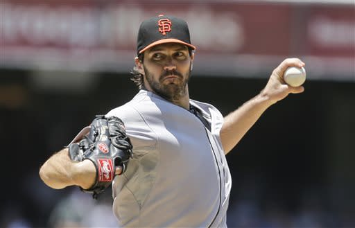 San Francisco Giants starting pitcher Barry Zito works against the San Diego Padres in the first inning of a baseball game in San Diego, Sunday, July 14, 2013. Zito only pitched two innings before being relieved. (AP Photo/Lenny Ignelzi)
