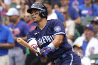 Chicago Cubs' Robinson Chirinos watches his solo home run during the fourth inning of a baseball game against the Arizona Diamondbacks in Chicago, Friday, July 23, 2021. (AP Photo/Nam Y. Huh)