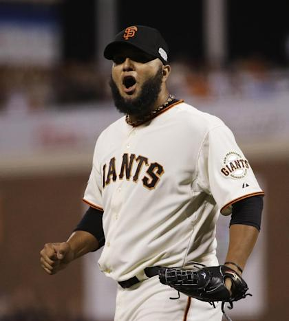 Yusmeiro Petit reacts after the sixth inning of Game 4 of the World Series. (AP Photo)