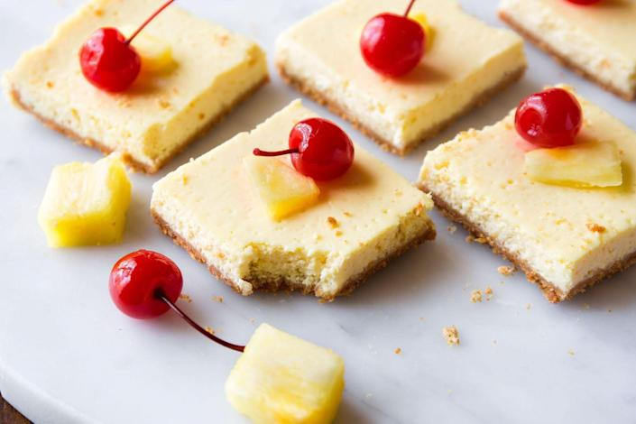 """<p>The best news we've heard so far this year is that these bars are only 130 calories.</p><p>Get the recipe from <a href=""""https://www.delish.com/cooking/recipe-ideas/a45564/skinny-pineapple-cheesecake-bars/"""" rel=""""nofollow noopener"""" target=""""_blank"""" data-ylk=""""slk:Delish"""" class=""""link rapid-noclick-resp"""">Delish</a>.<br></p>"""