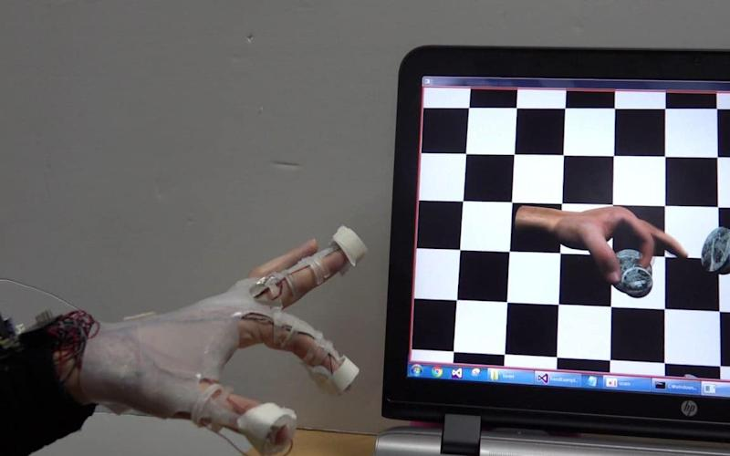 The glove allows a user to pick up objects as if they are real - Korea Institute of Science and Technology