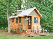 """<p>The 204-square-foot """"Wind River Bungalow"""" is the Chattanooga, Tennessee, home of tiny house enthusiasts Travis and Brittany Pyke, who started <a href=""""http://www.windrivertinyhomes.com/store/wind-river-bungalow-plans"""" rel=""""nofollow noopener"""" target=""""_blank"""" data-ylk=""""slk:Wind River Custom Homes"""" class=""""link rapid-noclick-resp"""">Wind River Custom Homes</a> to help others fulfill their dreams of living simply in mini dream homes. Constructed of rain-screen cedar and hardy siding for extreme durability, the bungalow is full of custom features, including a pine and cedar interior, polymer concrete counters, and a loft ladder integrated into the shelving system.</p><p><a class=""""link rapid-noclick-resp"""" href=""""https://www.windrivertinyhomes.com/wind-river-bungalow"""" rel=""""nofollow noopener"""" target=""""_blank"""" data-ylk=""""slk:SEE INSIDE"""">SEE INSIDE</a></p>"""