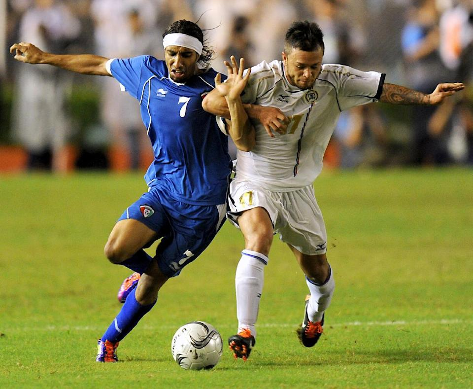 In this file photo, Philippines' midfielder Stephan Schrock fights for the ball with a Kuwaiti player during a FIFA World Cup qualifying match, in Manila, on July 28, 2011 (AFP Photo/Noel Celis)