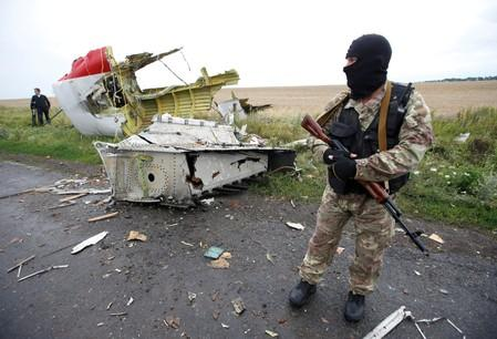 FILE PHOTO: Pro-Russian separatist stands at crash site of Malaysia Airlines flight MH17 near Hrabove