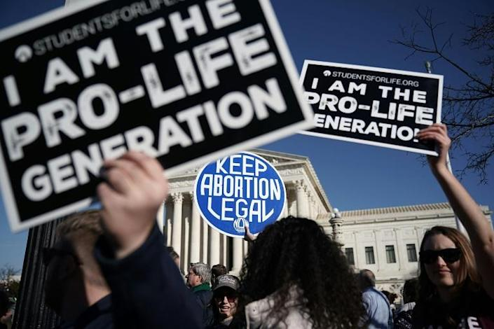 Trump promised to nominate only Supreme Court justices who were opposed to abortion rights and favorable to lenient gun laws (AFP Photo/ALEX WONG)