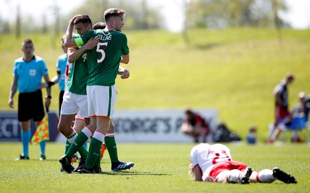 Soccer Football - UEFA European Under-17 Championship - Group C - Republic of Ireland v Denmark - St. George's Park Stadium, Burton-upon-Trent, Britain - May 8, 2018 Republic of Ireland players celebrate after the match as Denmark players look dejected Action Images via Reuters/Carl Recine