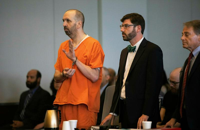 Craig Hicks, in handcuffs,pleaded guilty to three counts of first-degree murder in the 2015 killings of three young Muslims in North Carolina. (Photo: Associated Press)