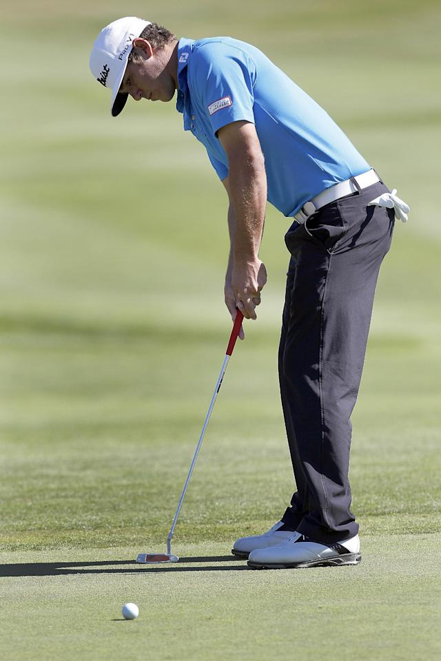 Brooks Koepka putts on the first green during the final round of the Frys.com Open golf tournament, Sunday, Oct. 13, 2013, in San Martin, Calif. (AP Photo/Tony Avelar)