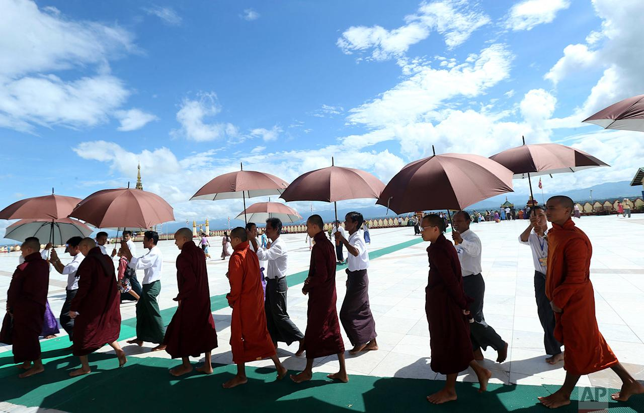 <p>Buddhist monks walk around the Uppatasanti Pagoda during celebrations of the full moon day of Thadingyut, or lighting festival, to mark the end of Buddhist Lent in Naypyitaw, Myanmar. Thadingyut festival is held every year in October in Myanmar, a predominantly Buddhist country. (AP Photo/Aung Shine Oo) </p>