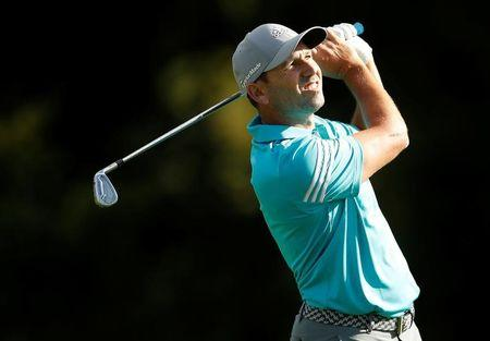 Garcia on top in weather-hit Singapore Open