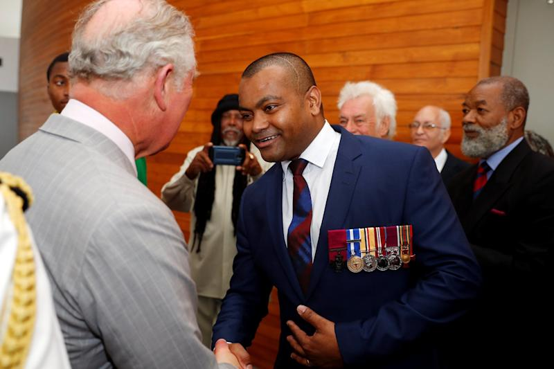 Lance Sergeant Johnson Beharry met Prince Charles on the royal's visit to Grenada (REUTERS)
