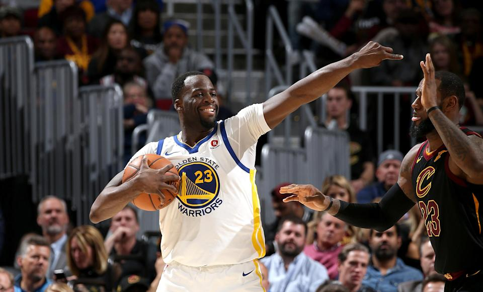 Draymond Green smiles as he sets up the Warriors' offense Monday night against LeBron James and the Cavs. (Getty Images)